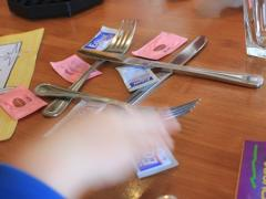 Silverware and Sugar Packet Tic-Tac-Toe
